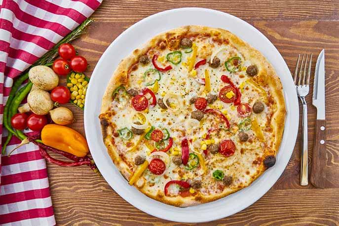 Ricetta per una pizza cotta nella stufa a legna